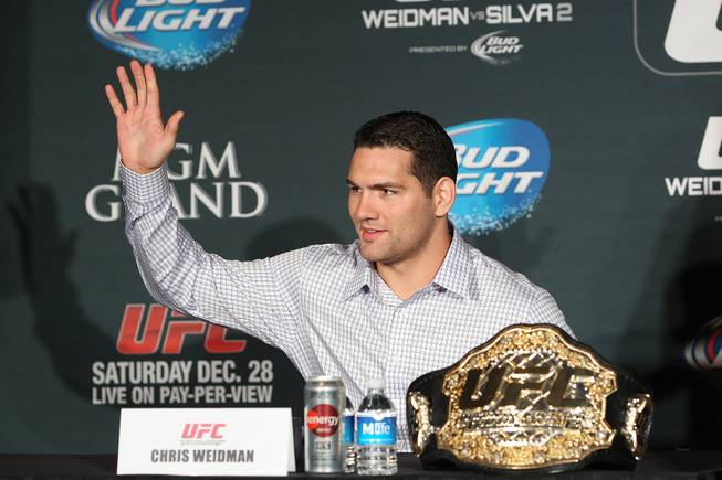 Chris Weidman waves during a news conference to promote his December fight against Anderson Silva at UFC 168 Tuesday, Sept. 24, 2013.