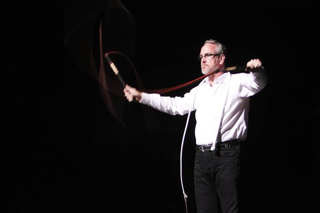 Chris Camp from Springfield, Illinois breaks the sound barrier with his whips during his performance at the Station to Station event at The Skyline Drive-In Theater in Barstow, Calif., Sept. 24, 2013. He and his family are frequently asked to perform at events across the country.