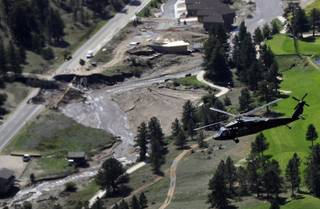 This aerial photo shows flood damage in Greeley Colo. during a helicopter tour of flood-ravaged areas by Vice President Joe Biden, Gov. John Hickenlooper, and FEMA officials Monday, Sept. 23, 2013.