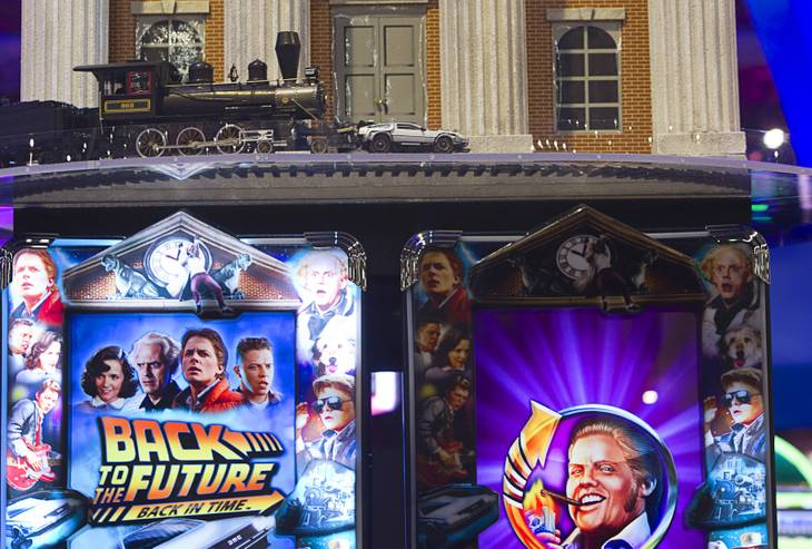 """Back to the Future"" video slot machines by IGT are crowned by a circular run of train tracks with a model locomotive pushing a DeLorean time machine during the G2E convention at the Sands Expo Center Wednesday, Sept. 25, 2013."