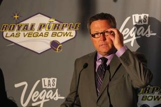Executive Director of the Royal Purple Las Vegas Bowl Dan Hanneke speaks during the kickoff luncheon for the annual bowl game Wednesday, Sept. 25, 2013. Royal Purple, a manufacturer of motor oil and other lubricants, was announced as the new title sponsor of the game for the next three years.