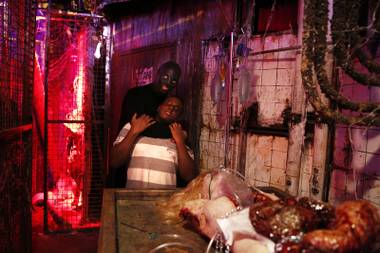 Corey Walker, playing The Collector, claims victim Deandre Scott inside Fright Dome at Circus Circus in Las Vegas on Thursday, Sept. 26, 2013.