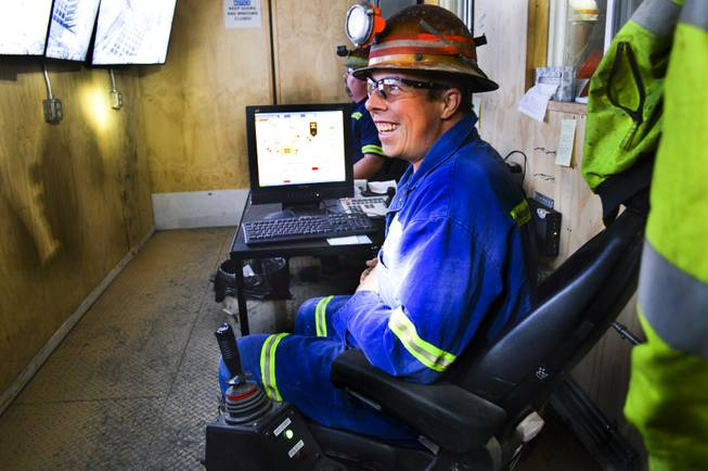 Some miners, like David Youny, operate equipment remotely at Newmont Mining Corp.'s Leeville underground mine. Here, Youny can work the rock breaker with joysticks and television monitors, Sept. 26, 2013.  Mark Ward, mine manager, said remote operations can protect miners.