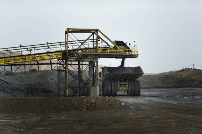 A Caterpillar dump truck that is rated to carry 240 tons takes on a load on Sept. 26, 2013, at Newmont Mining Corp.'s Carlin complex west of Elko.