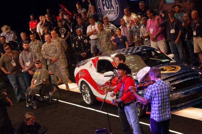 Clay Walker performs during the 2013 Barrett-Jackson Collector Car Auction ...