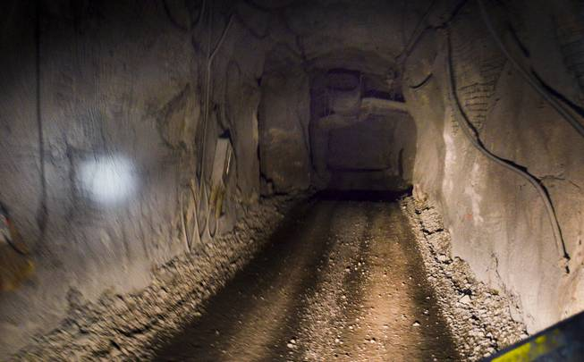 A  tunnel is seen from the back of a vehicle used to haul workers through the Leeville underground mine, operated by the Newmont Mining Corp., on Sept. 26, 2013. The photo was taken about 2,000 feet under ground. light to the left is due to a a mining helmet.