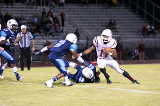 Jocquez Kalili, Desert Oasis running back, makes an attempt to gain some yards against Canyon Springs during their game Friday, Sept. 27, 2013. Canyon Springs beat Desert Oasis 30-7 .