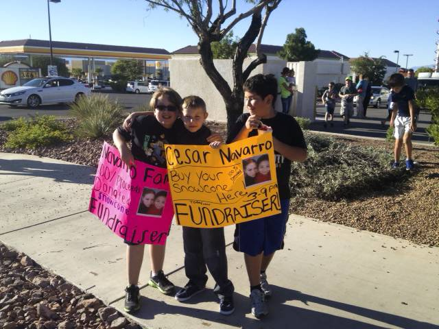 Snowcone fundraiser for the family of Cesar Navarro, a 9-year-old boy who was allegedly killed by his teenage brother last week at their Henderson home. From L to R; Loren Ambrose, Rylan McKinnon and Nicolas Araya