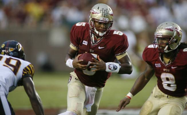 Florida State quarterback Jameis Winston, center, runs in the second quarter of an NCAA college football game against Bethune-Cookman on Saturday, Sept. 21, 2013, in Tallahassee, Fla.