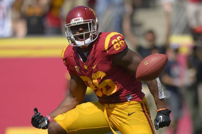 Southern California tight end Xavier Grimble celebrates after scoring a touchdown during the first half of an NCAA college football game against Utah State, Saturday, Sept. 21, 2013, in Los Angeles.