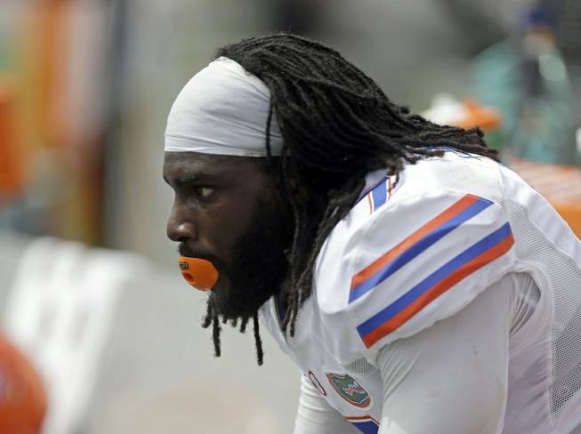 Florida linebacker Ronald Powell watches the final minutes of the Gators' 21-16 loss to Miami on Saturday, Sept. 7, 2013, in Miami Gardens, Fla.