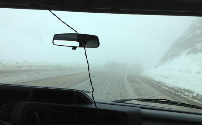 There was snow and reduced visibility west of Elko on Sept. 26, 2013, as seen in this picture out the windshield of a passenger van.