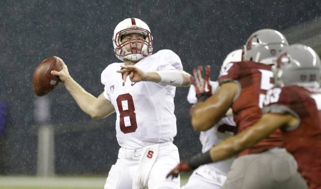 Stanford quarterback Kevin Hogan drops back to pass against Washington State in the second half of an NCAA college football game Saturday, Sept. 28, 2013, in Seattle. Stanford won 55-17.