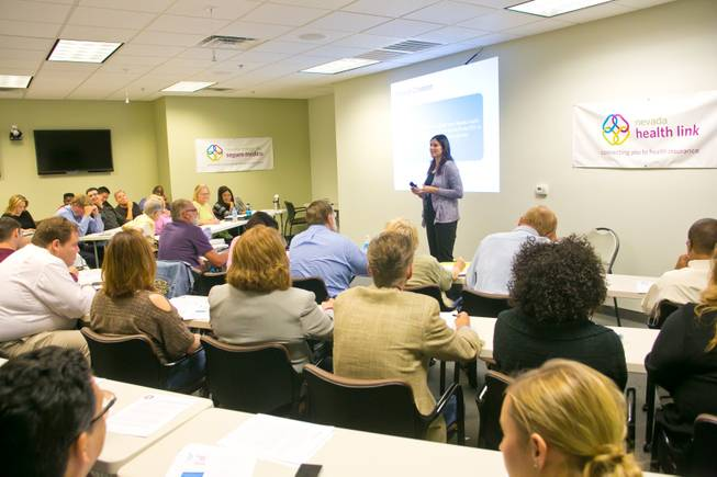 Insurance agents and brokers attend a training seminar at Nevada Health Link regarding Obamacare, Friday Sept. 27, 2013.