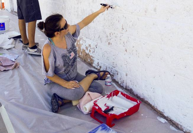 Nicole Phillips paints a wall at the Huntridge Theater on Saturday, Sept. 28, 2013.
