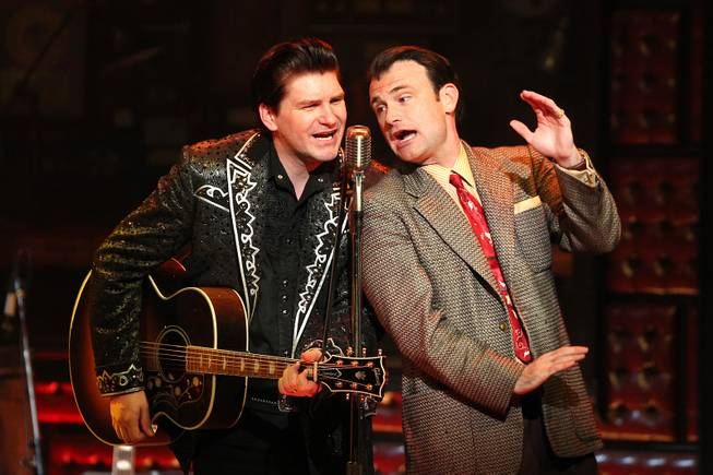 Benjamin Hale performs as Johnny Cash and Marc Donovan performs as Sam Phillips  during the Million Dollar Quartet show at Harrah's Tuesday, Oct. 1, 2013.