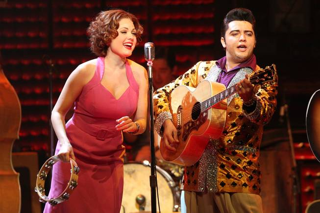 Felice Garcia performs as Dyanne and Cole performs as Elvis Presley during the Million Dollar Quartet show at Harrah's Tuesday, Oct. 1, 2013.