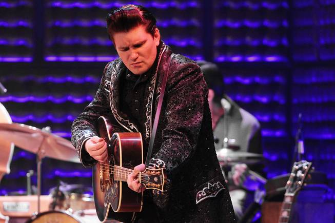 Benjamin Hale performs as Johnny Cash during the Million Dollar Quartet show at Harrah's Tuesday, Oct. 1, 2013.