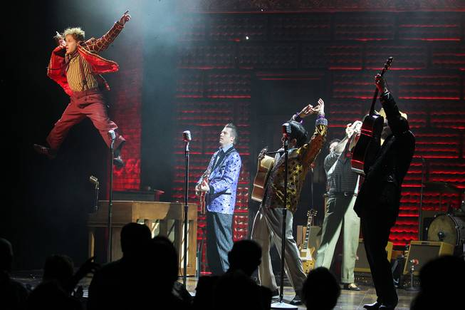 Martin Kaye leaps off a piano while performing as Jerry Lee Lewis during the Million Dollar Quartet show at Harrah's Tuesday, Oct. 1, 2013.