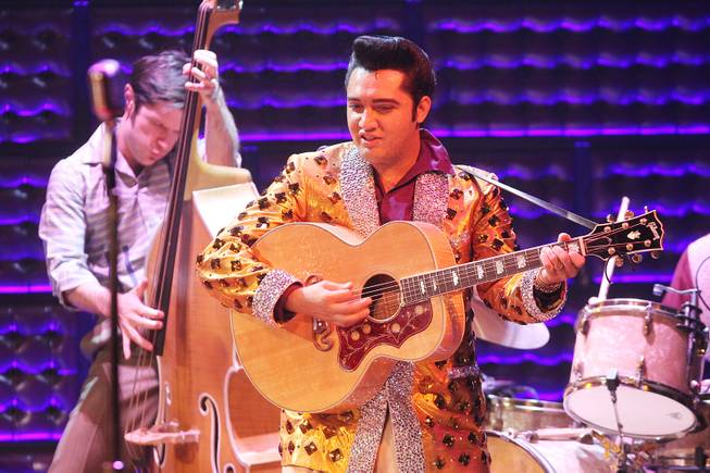 Cole performs as Elvis Presley during the Million Dollar Quartet show at Harrah's Tuesday, Oct. 1, 2013.