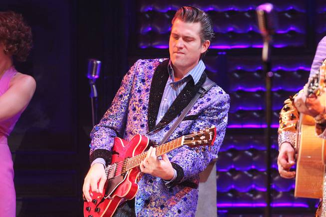 Robert Britton Lyons performs as Carl Perkins during the Million Dollar Quartet show at Harrah's Tuesday, Oct. 1, 2013.