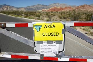 The gates to Red Rock National Conservation Area are seen closed because of the federal government shutdown Tuesday, Oct. 1, 2013.
