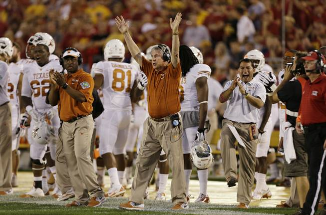 Texas head coach Mack Brown reacts during the first half of an NCAA college football game against Iowa State, Thursday, Oct. 3, 2013, in Ames, Iowa.