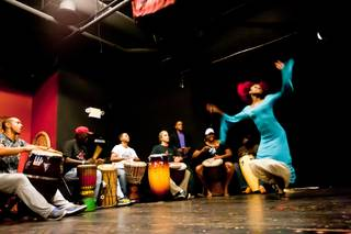 Musicians play for Producer Wassa Coulibaly while she dances during rehearsal of