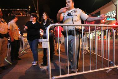Metro officers direct pedestrians to the entrance of the traffic flow on East Fremont St. early Saturday, Oct. 5, 2013.