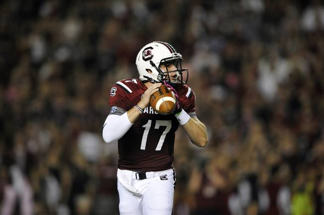 South Carolina quarterback Dylan Thompson (17) looks to throw against Kentucky during the first half of an NCAA college football game, Saturday, Oct. 5, 2013, in Columbia, S.C.