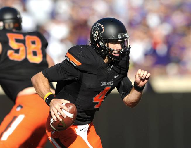 Oklahoma State quarterback J.W. Walsh runs during the second half of an NCAA football game against Kansas State in Stillwater, Okla., Saturday, Oct. 5, 2013. Oklahoma State won 33-29.