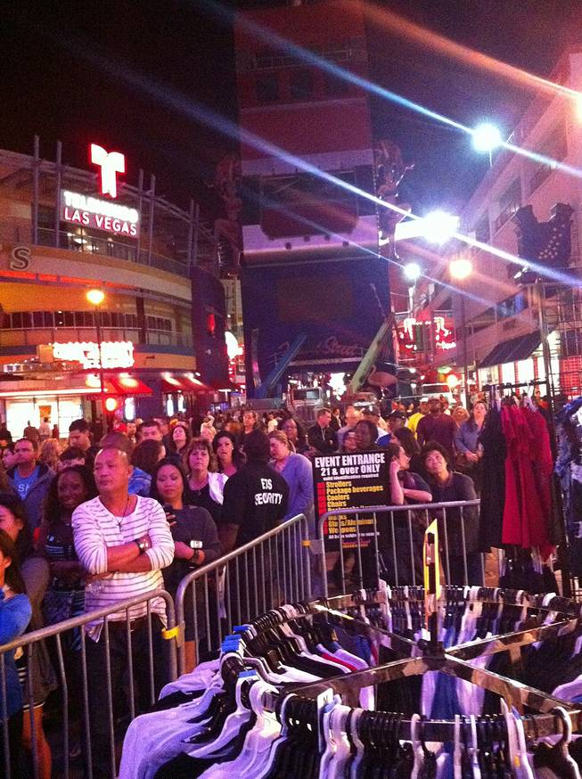 A large crowd waits in line before crossing barricades to enter the Fremont Street Experience on Friday, Oct. 4, 2013.