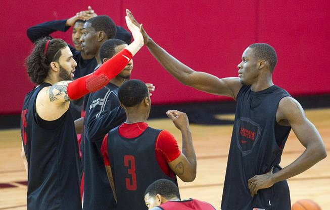 Carlos Lopez-Sosa, left, high fives with Demetris Morant during the first UNLV basketball practice of the season at UNLV's Mendenhall Center Monday, Oct. 7, 2013.
