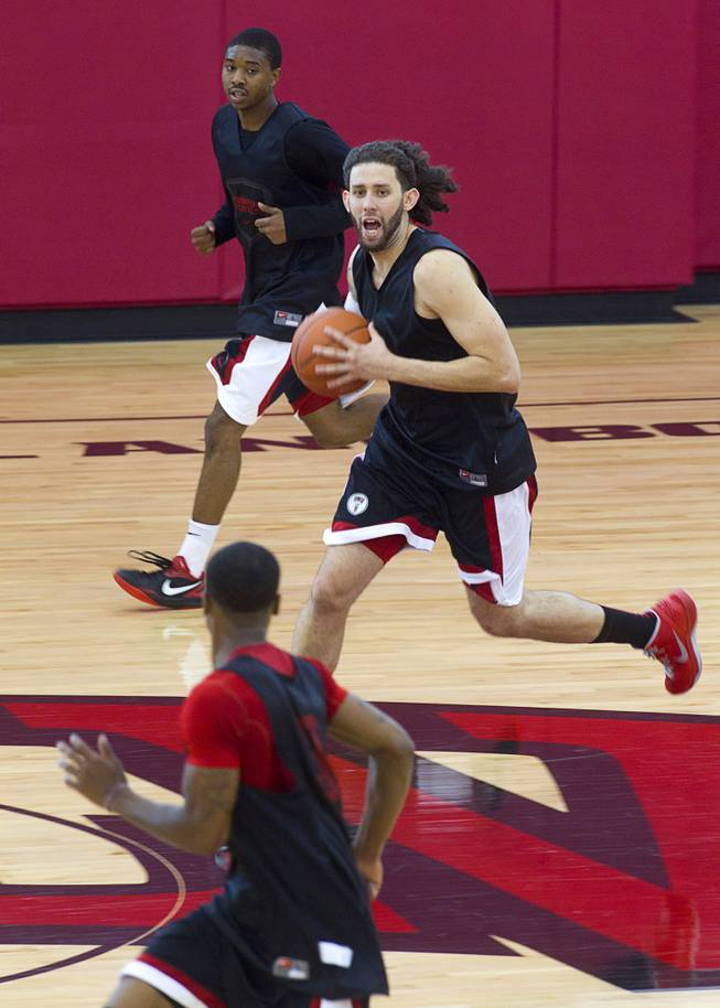 Carlos Lopez-Sosa takes the ball down court during the first UNLV basketball practice of the season at UNLV's Mendenhall Center Monday, Oct. 7, 2013.