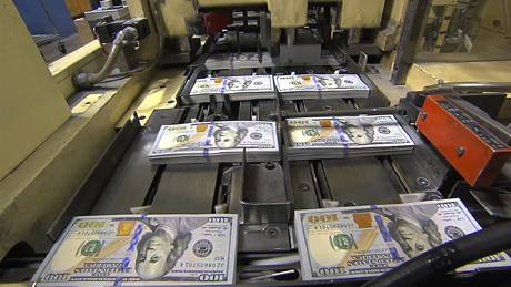 An undated handout screen grab of the new $100 notes on the printing press at the Bureau of Engraving and Printing. The Federal Reserve will begin circulating a new $100 bill on Tuesday, Oct. 8, 2013, with some modern and colorful anti-counterfeiting features, after overcoming problems that postponed its debut for more than two and a half years.