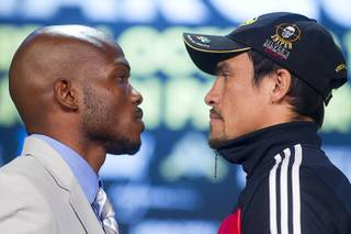 Undefeated WBO welterweight champion Timothy Bradley Jr., left, and Juan Manuel Marquez face off during a news conference at the Wynn on Wednesday, Oct. 9, 2013. Bradley will defend his title against Marquez on Saturday at the Thomas & Mack Center.