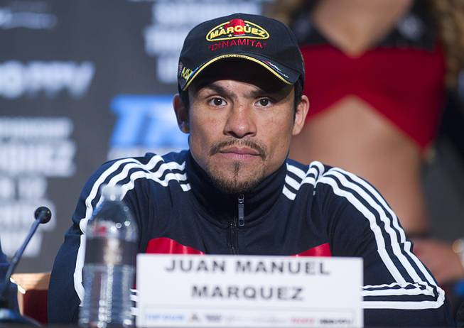 Mexican boxer Juan Manuel Marquez attends a news conference at the Wynn Las Vegas Resort Wednesday, Oct. 9, 2013. Marquez will challenge undefeated WBO welterweight champion Timothy Bradley Jr.  for the title at the Thomas & Mack Center Saturday.