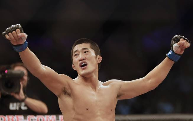 Dong Hyun Kim, from South Korea, celebrates after defeating Erick Silva, from Brazil, during their Welterweight mixed martial arts bout at the Ultimate Fighting Championship (UFC) in Barueri, on the outskirt of Sao Paulo, Brazil, Wednesday, Oct. 9, 2013.