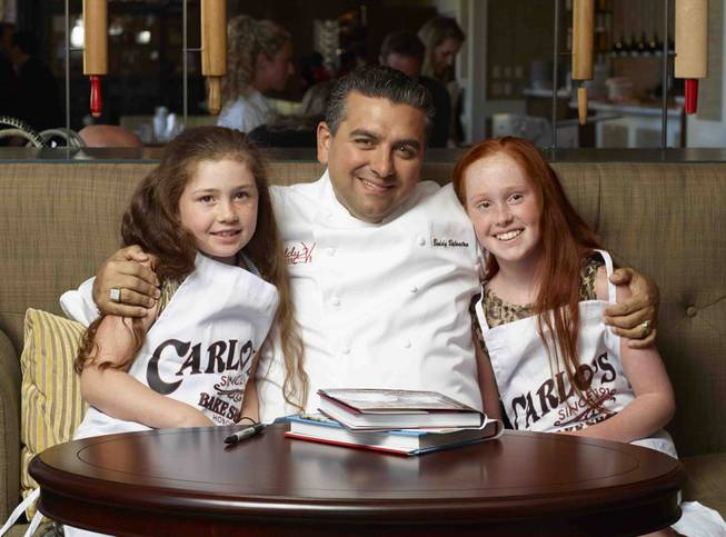 Buddy Valastro and two kids.