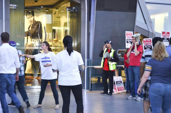 "The Alliance to Protect Nevada Jobs provided this image of the Culinary protest on Oct. 5, 2013 outside of the Cosmopolitan in which members of the union called tourists ""losers"" and ""jerks"" for going into the Cosmopolitan."