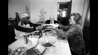 Mike Tyson, Cus D'Amato and his wife at a family dinner.