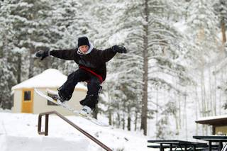 Snowboarder Jake Buell rides a handrail at the Las Vegas Ski & Snowboard Resort in Lee Canyon Thursday, Oct. 10, 2013.