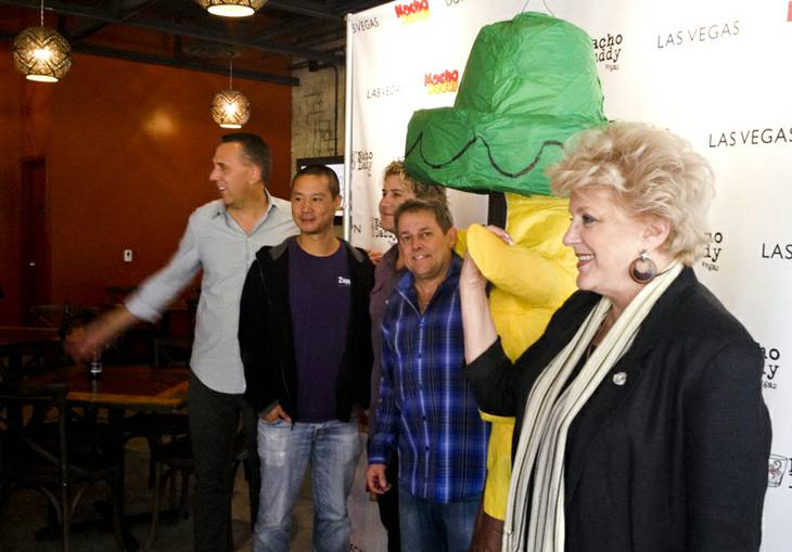 Mayor Carolyn Goodman, foreground, joins the four Nacho Daddy investors —from left, Fred Mossler, Tony Hsieh, Paul Hymas and Keith Glynn — at a ribbon cutting for the new restaurant, 115 N. 4th St. downtown.