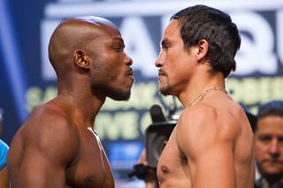 Undefeated WBO welterweight champion Timothy Bradley Jr., left, and Juan Manuel Marquez of Mexico face off during an official weigh-in at the Wynn Las Vegas Friday, Oct. 11, 2013. Bradley will defend his title against Marquez at the Thomas & Mack Center on Saturday.