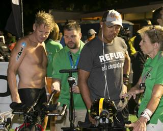 Chef Gordon Ramsay and retired NFL star Hines Ward go over their bikes before the start of the 2013 Go Pro Ironman World Championship Triathlon in Kailua-Kona, Hawaii, on Saturday, Oct. 12, 2013.