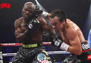 Undefeated WBO welterweight champion Timothy Bradley Jr., left, takes a punch from Juan Manuel Marquez of Mexico during their title fight at the Thomas & Mack Center Saturday, Oct. 12, 2013.