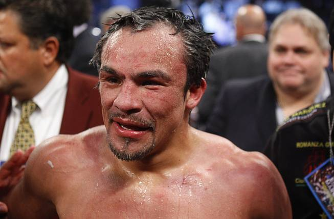 Juan Manuel Marquez of Mexico stands in the rings after going 12 rounds with WBO welterweight champion Timothy Bradley Jr. at the Thomas & Mack Center Saturday, Oct. 12, 2013. Bradley won by split decision.
