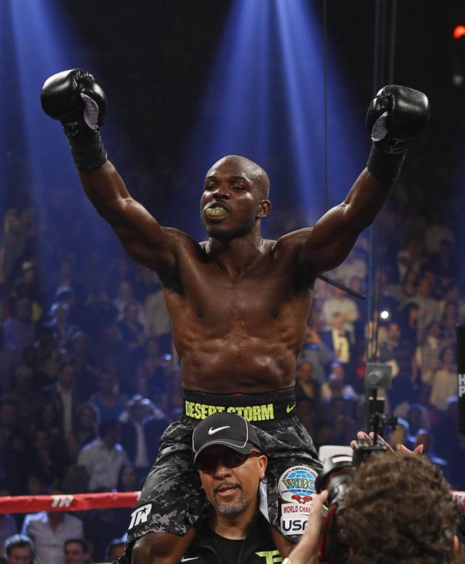 Undefeated WBO welterweight champion Timothy Bradley Jr. celebrates his victory over Juan Manuel Marquez of Mexico at the Thomas & Mack Center Saturday, Oct. 12, 2013.