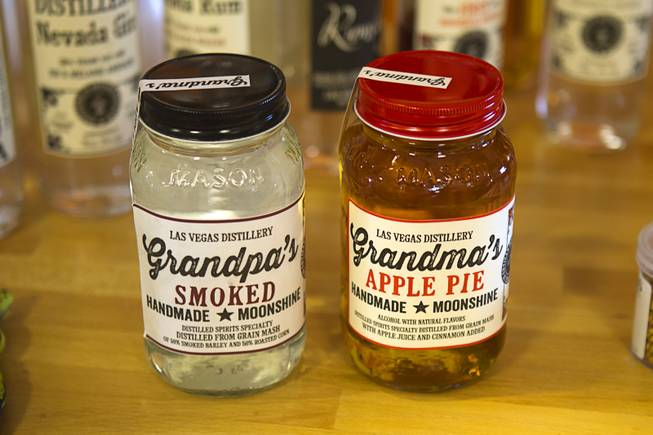 The Las Vegas Distillery's newest spirit, right, Grandma's Apple Pie Moonshine, is shown during a tasting at the distillery in Henderson Saturday, Oct. 12, 2013. Grampa's Smoked Moonshine will be available soon, said distillery owner George Racz. The distillery will feature additional tastings on Oct. 19 and 26.