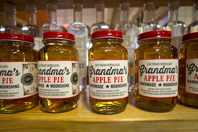Mason jars of the Las Vegas Distillery's newest spirit, Grandma's Apple Pie Moonshine, are displayed during an unveiling and tasting at the distillery in Henderson Saturday, Oct. 12, 2013. The distillery will feature additional tastings on Oct. 19 and 26.